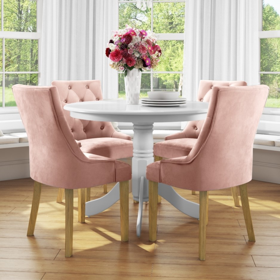 small round dining table in white with 4 velvet chairs in